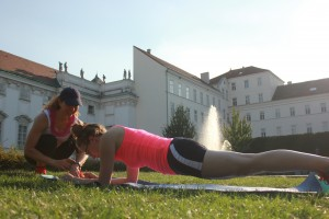 Fitness trainer coaching plank