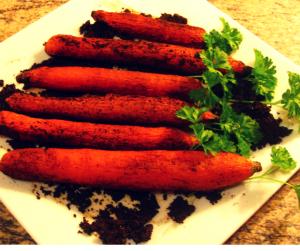 Dreckige Karotten auf dem Teller